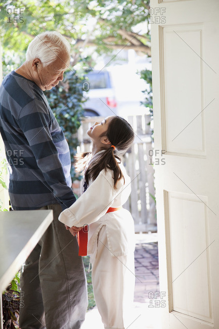 Japanese grandfather and granddaughter holding hands
