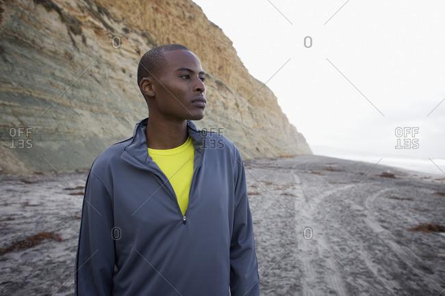 Black man standing on beach