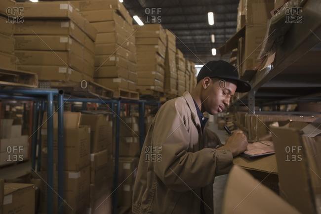 Black man working in warehouse
