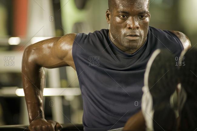 Man exercising in health club