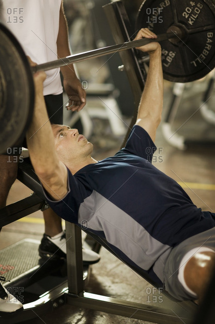 Man lifting weights in health club