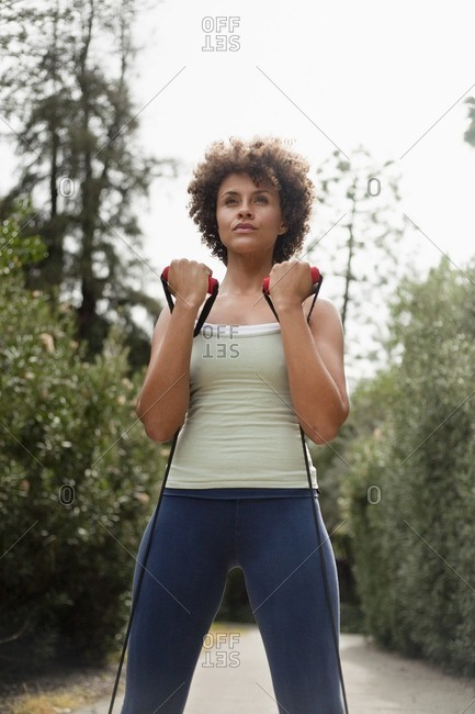 Mixed race woman exercising in park