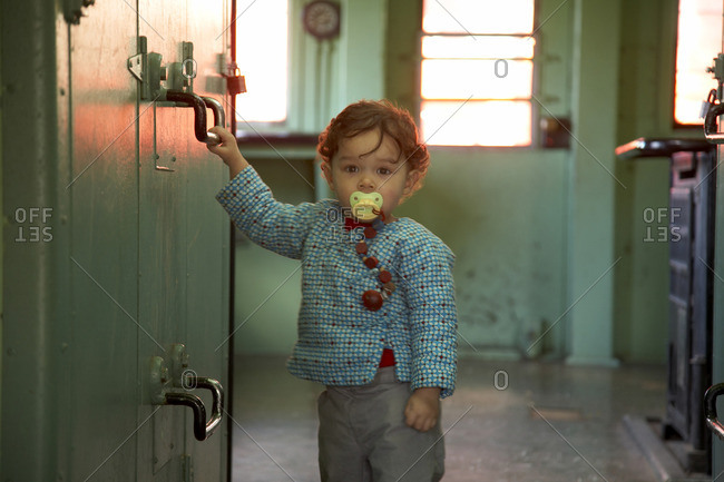 Mixed race boy standing in kitchen