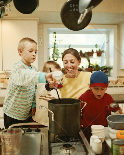 Caucasian mother and sons preparing food