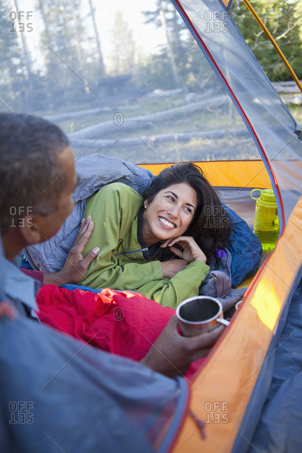 Couple camping and laying in tent