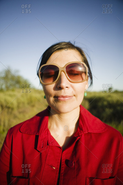Smiling mixed race woman with eyes closed