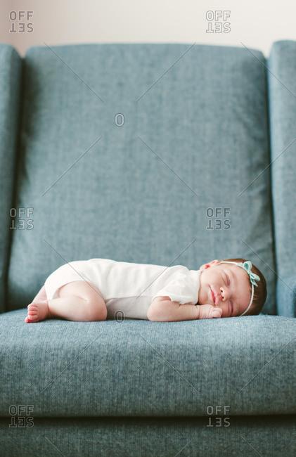 Newborn asleep on a chair