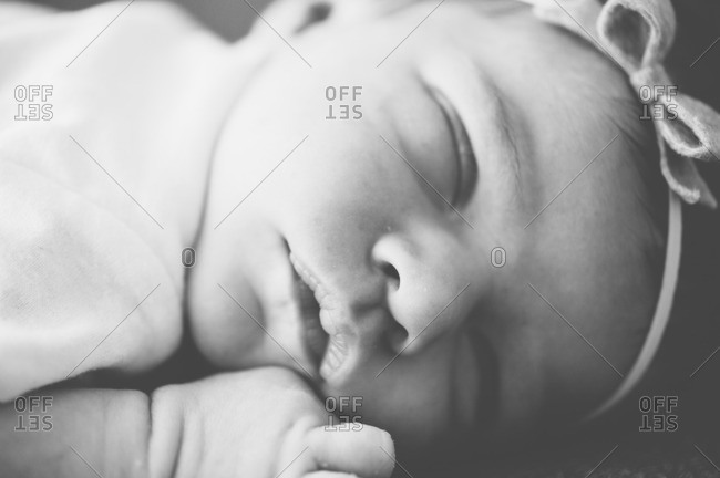 A newborn sleeping in close up