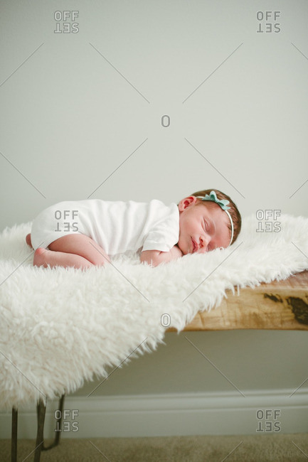 Baby asleep on fuzzy blanket
