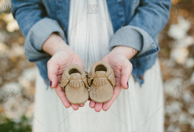 Woman holding baby moccasins