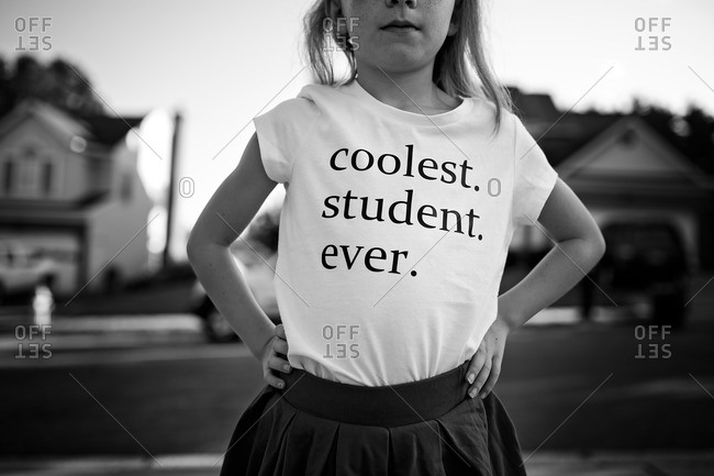 "Little girl wearing shirt that says ""coolest student ever"""