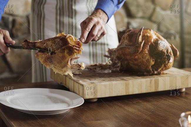 Man carving Thanksgiving turkey