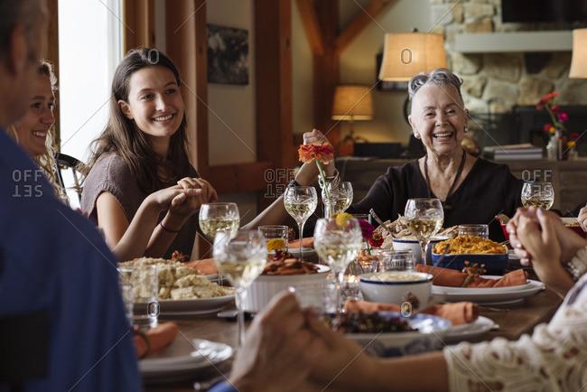 Family saying prayer for Thanksgiving dinner