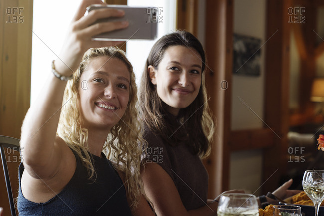Two women taking selfie together at Thanksgiving dinner