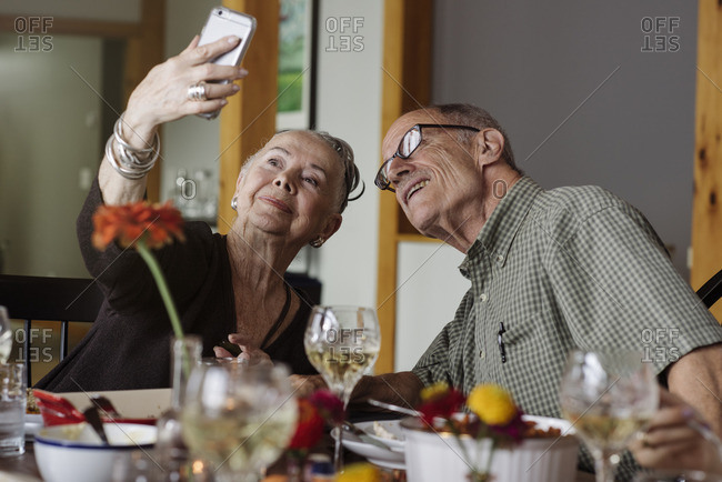 Senior couple taking selfie at Thanksgiving dinner