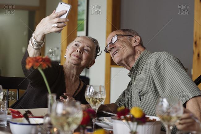 Senior couple taking selfie at Thanksgiving dinner
