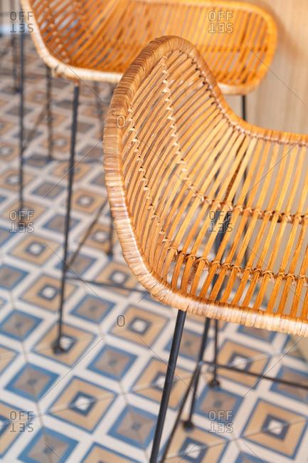 Woven rattan chairs on tiled floor