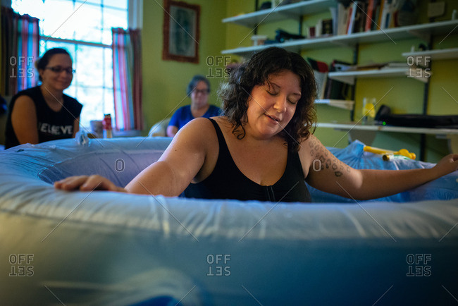 Woman in a birthing tub during a home delivery