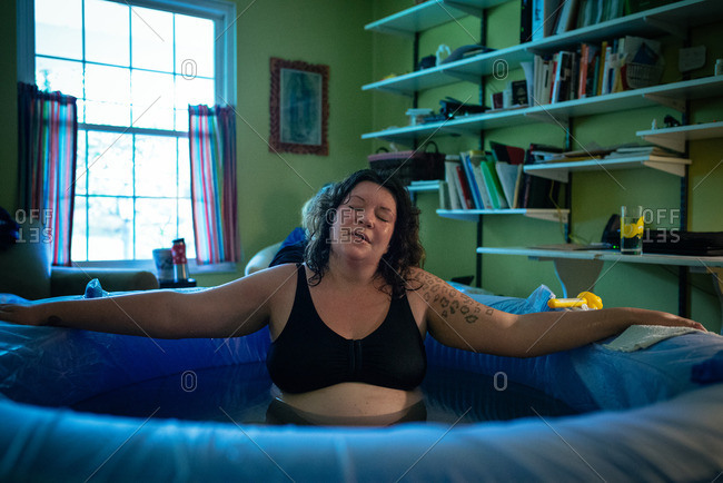 Woman in a tub during a home birth