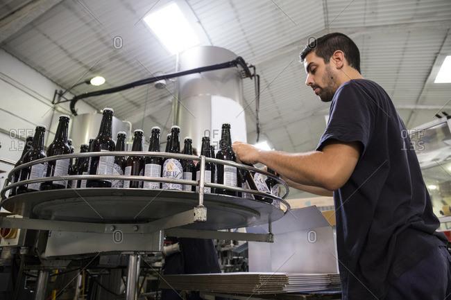 August 23, 2016: Man working in beer bottling plant