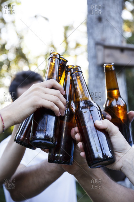 Friends toasting with bottles of beer