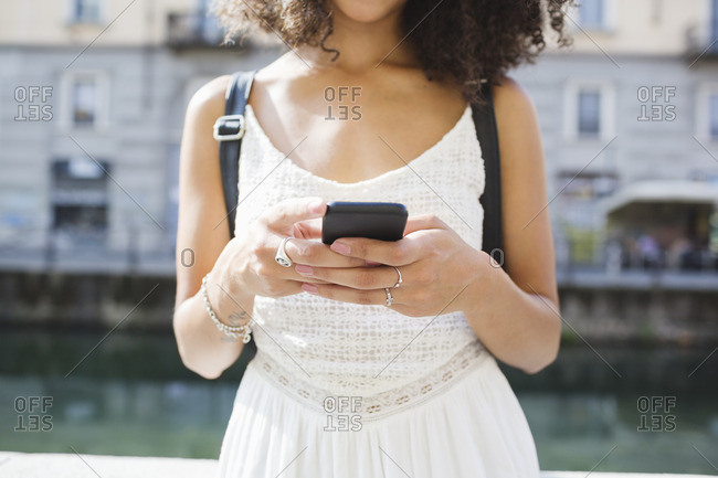 Young woman text messaging- partial view