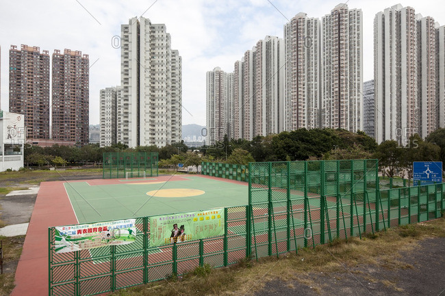 Tsing Yi, Hong Kong - December 9, 2011: Athletic field and high rise apartments