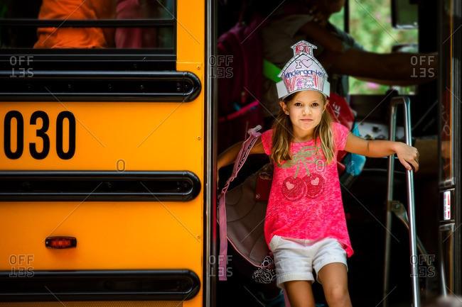 Girl getting off a school bus after school