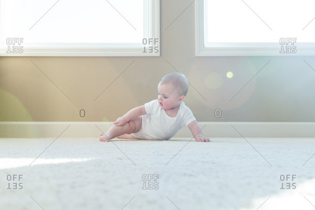 Baby crawling on the floor in the living room