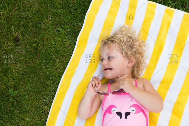 Portrait of a toddler girl sun bathing