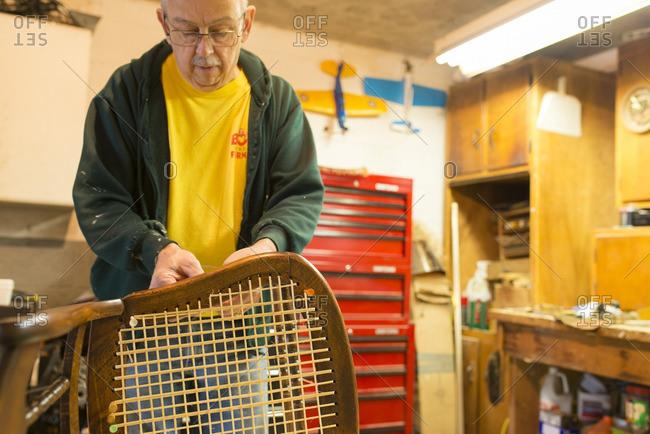 An artisan caning a chair