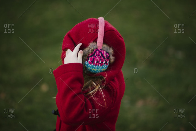 Girl in earmuffs and hooded coat