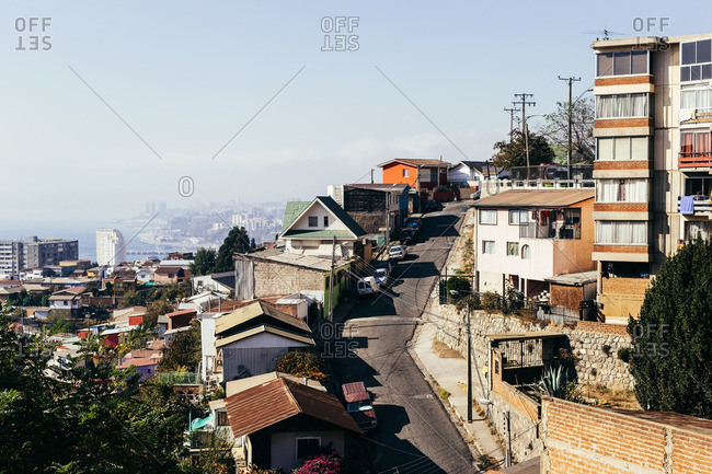 Valparaiso, Chile - May 15, 2015: Winding road with city buildings overlooking Valpairaso