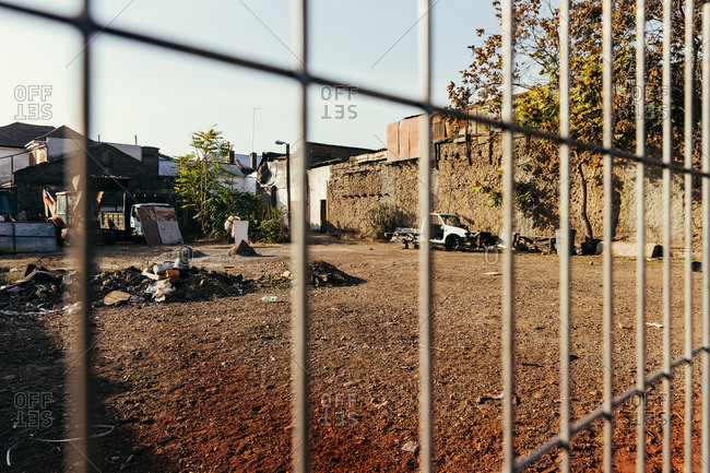Santiago, Chile - May 13, 2015: Fenced vacant lot with trash at sunset