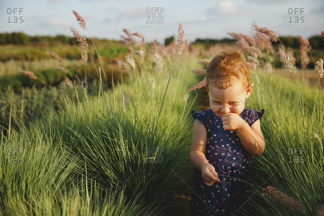 Girl in farm field giggling