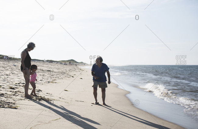 Grandparents with grandchild at the beach