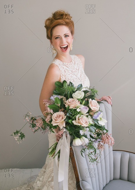A laughing bride in studio