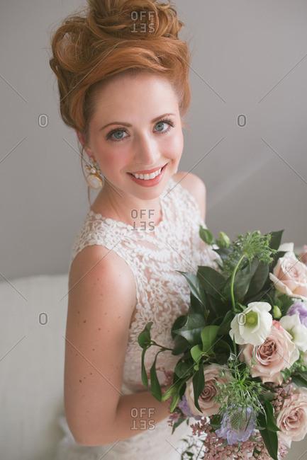 A smiling bride in studio