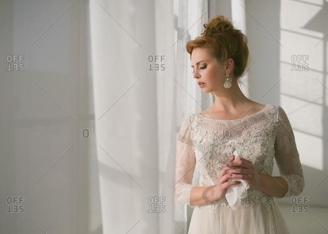 Bride by window in studio