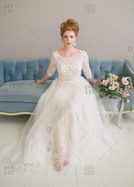 Bride on an antique couch