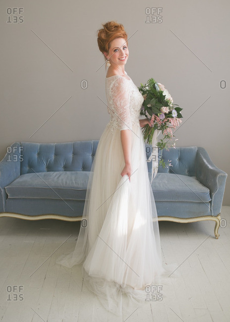 Bride holding tulle of her gown