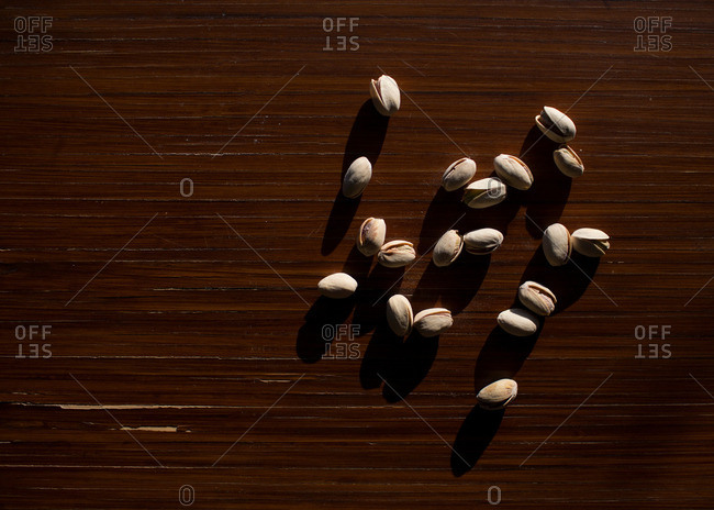 Pistachios on table with shadows