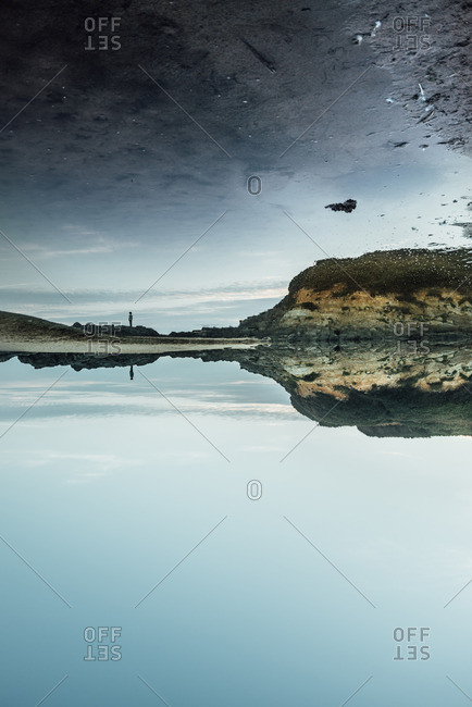 Dramatic shore in reflection