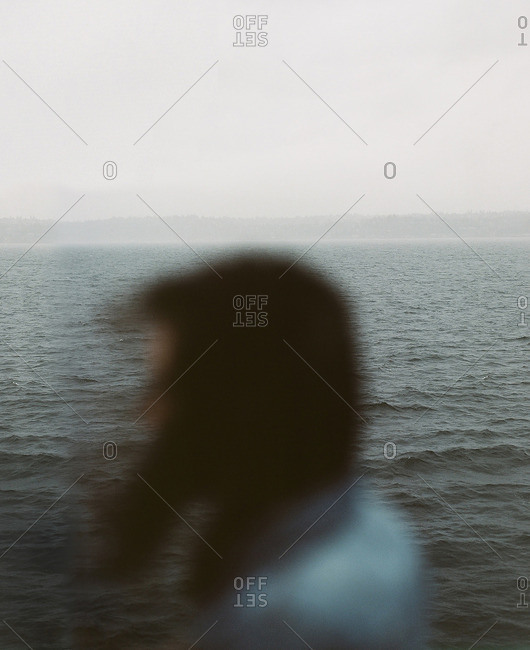 Person standing in front of the sea