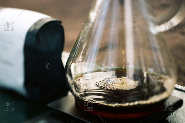 Close-up of a coffee pot with a small amount of hot coffee