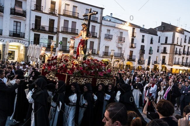 Caceres, Spain - April 12, 2014: Religious ceremony with Jesus and a crucifix in Caceres during Holy Week in Spain