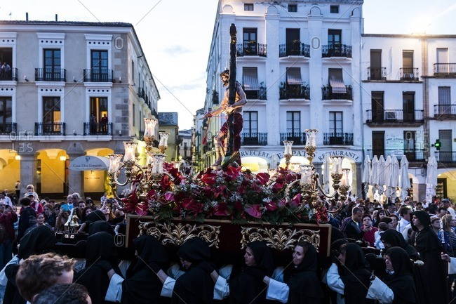 Caceres, Spain - April 12, 2014: Parade during a religious ceremony with Jesus and a crucifix in Caceres during Holy Week in Spain