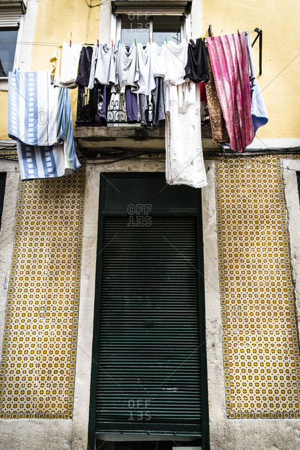 Laundry hanging outside of a window in Lisbon in Portugal