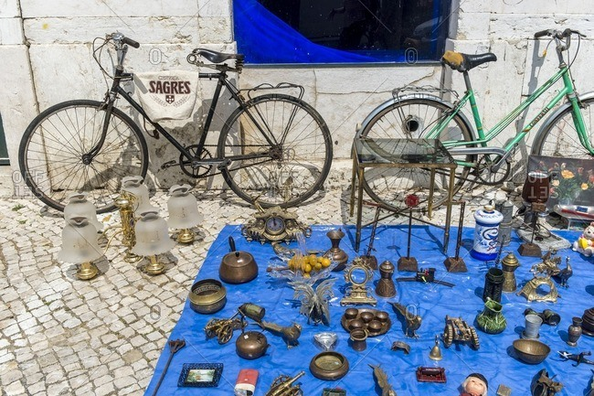 Lisbon, Portugal - April 15, 2014: Feira da lard, a flea market held twice weekly attracting locals and tourists, in Alfama, Lisbon
