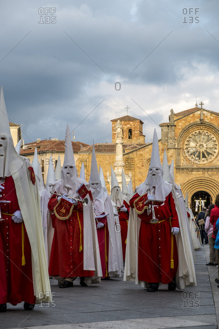 Avila, Spain- April 19, 2014: Men wearing red and white capirotes during a religious ceremony in Avila during Holy Week in Spain